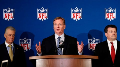 NFL commissioner Roger Goodell, center, is flanked by Pittsburgh Steelers president Art Rooney II, left, and Arizona Cardinals owner Michael Bidwill during a news conference where he announced that NFL team owners have reached agreement on a new league policy that requires players to stand for the national anthem or remain in the locker room, during the NFL owner's spring meeting Wednesday, May 23, 2018, in Atlanta. (AP Photo/John Bazemore)