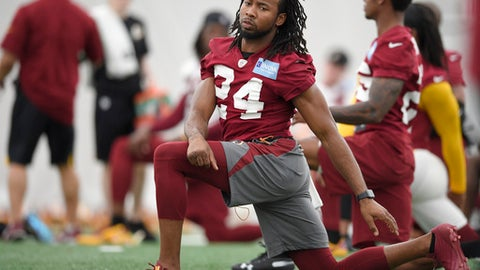 Washington Redskins defensive back Josh Norman (24) stretches during an NFL football team practice, Wednesday, May 23, 2018, in Ashburn, Va. (AP Photo/Nick Wass)