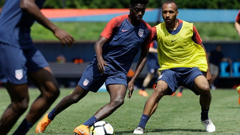 United States' Tim Weah, center, and Julian Green battle for the ball during soccer practice at the University of Pennsylvania in Philadelphia, Wednesday, May 23, 2018. (AP Photo/Matt Rourke)