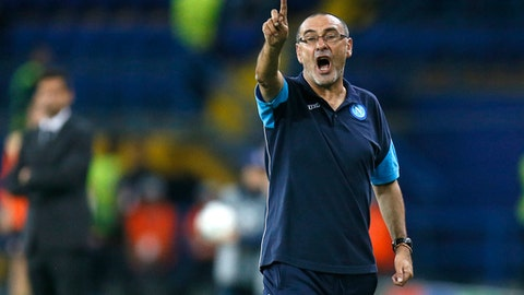 FILE - In this Wednesday, Sept. 13, 2017 file photo, Napoli's head coach Maurizio Sarri shouts instructions to his players during the Group F Champions League soccer match between Shakhtar Donetsk and Napoli at the Metalist Stadium in Kharkiv, Ukraine. Napoli's president has thanked coach Maurizio Sarri for his contributions after the Serie A club reportedly reached a deal to hire Carlo Ancelotti as his replacement. Napoli have not announced Sarri's departure, but a messaged posted on Twitter by president Aurelio De Laurentiis on Wednesday, May 23, 2018 and retweeted by the club's official account, seemed to confirm he is leaving. (AP Photo/Efrem Lukatsky, File )