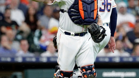 Houston Astros catcher Brian McCann (16) attempts the throw to first base on the infield hit by San Francisco Giants Brandon Crawford that deflected off of Houston Astros relief pitcher Will Harris (36) during the seventh inning of a baseball game Wednesday, May 23, 2018, in Houston. (AP Photo/Michael Wyke)