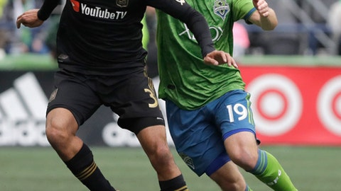 FILE - In this Sunday, March 4, 2018 file photo, Seattle Sounders forward Harry Shipp, right, challenges Los Angeles defender Steven Beitashour during the first half of an MLS soccer match in Seattle. The wait was short for LAFC defender Steven Beitashour, who was left off of Irans World Cup latest roster less than a week after his name was intriguingly included on the national teams preliminary list. Beitashour had been hoping for his second trip to soccers premier tournament. (AP Photo/Ted S. Warren, File)
