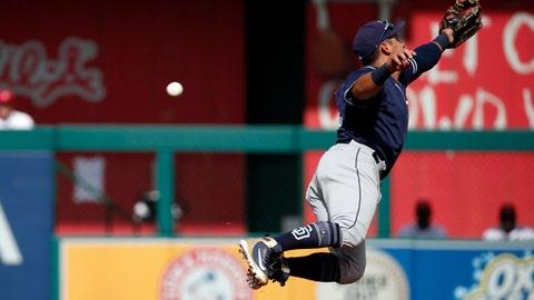 San Diego Padres third baseman Christian Villanueva jumps for a ball hit for a single by Washington Nationals' Matt Adams during the second inning of a baseball game at Nationals Park, Wednesday, May 23, 2018, in Washington. (AP Photo/Alex Brandon)