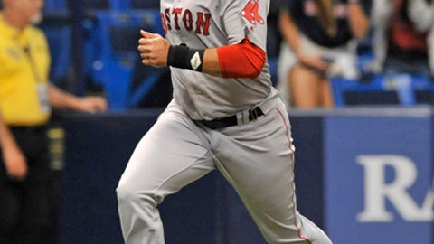 Boston Red Sox's J.D. Martinez scores the go-ahead run on a double by Xander Bogaerts off Tampa Bay Rays closer Alex Colome during the ninth inning of a baseball game Wednesday, May 23, 2018, in St. Petersburg, Fla. (AP Photo/Steve Nesius)