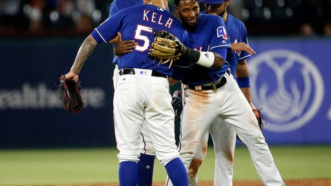 Texas Rangers relief pitcher Keone Kela (50) gets a hug from shortstop Jurickson Profar after the Rangers defeated the New York Yankees 12-10 during a baseball game Wednesday, May 23, 2018, in Arlington, Texas. (AP Photo/Michael Ainsworth)