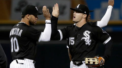 Chicago White Sox's Yoan Moncada (10) and Adam Engel celebrate the team's 11-1 win over the Baltimore Orioles in a baseball game Wednesday, May 23, 2018, in Chicago. (AP Photo/Charles Rex Arbogast)