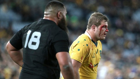 FILE - In this Aug. 20, 2016, file photo, Australia's James Slipper lines up for a line out as a cut on his face breeds during their Bledisloe Cup Rugby test match against New Zealand in Sydney, Australia. Australia test prop and Queensland Reds captain James Slipper has been suspended for two months for twice testing positive for cocaine, Rugby Australia said in a statement Thursday, May 24, 2018. (AP Photo/Rob Griffith, File)