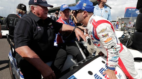 FILE - In this May 19, 2018, file photo, Tony Kanaan, right, of Brazil, talks with car owner AJ Foyt after Kanaan qualified for the Indianapolis 500 auto race at Indianapolis Motor Speedway in Indianapolis. Hes been coming to Indianapolis every May since 1958 and every year, crowds gather around the first garage stall in Gasoline Alley waiting to have an old photograph signed by their racing hero or merely to catch a glimpse of the former racing star. (AP Photo/Michael Conroy, File)