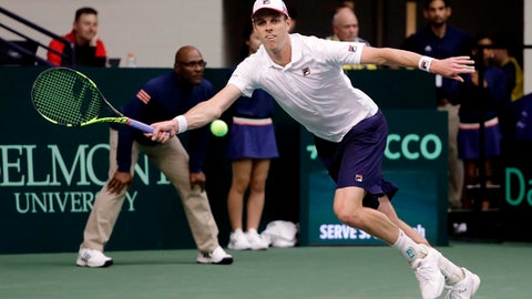 Sam Querrey, of the United States, returns a shot to Ruben Bemelmans, of Belgium, during a Davis Cup quarterfinal singles tennis match Friday, April 6, 2018, in Nashville, Tenn. (AP Photo/Mark Humphrey)