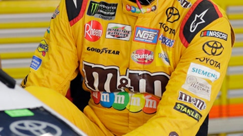 Kyle Busch climbs into his car before practice for the NASCAR Cup series auto race at Charlotte Motor Speedway in Charlotte, N.C., Thursday, May 24, 2018. (AP Photo/Chuck Burton)