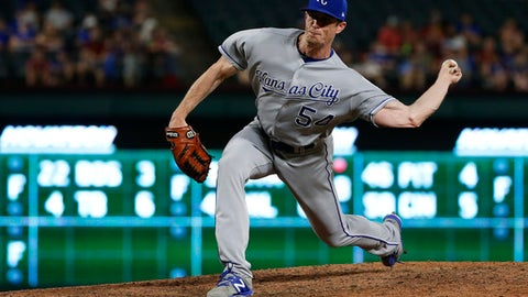 Kansas City Royals relief pitcher Tim Hill delivers to a Texas Rangers batter during the eighth inning of a baseball game Thursday