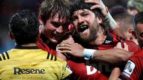 Crusaders Heiden Bedwell-Curtis, right, is congratulated by a teammate after scoring a try against the Hurricanes during their Super Rugby match in Christchurch, New Zealand, Friday, May 25, 2018. (AP Photo/Mark Baker)