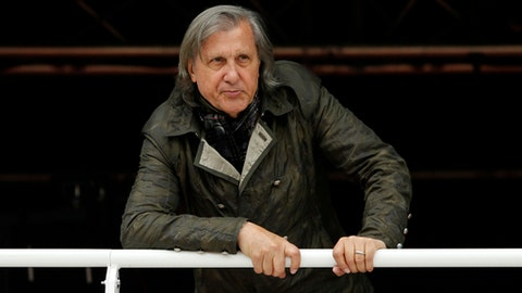 FILE - In this Monday, May 23, 2016, file photo, former Romanian tennis player Ilie Nastase watches a match at the French Open tennis tournament in Paris, France. Romanian police have arrested former tennis player Ilie Nastase twice in the same day, first on suspicion of driving while drunk and refusing to take a breathalyzer test, and then for riding a scooter without a license. (AP Photo/Alastair Grant, File)