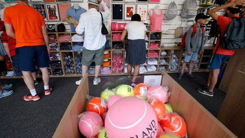 Visitors shop at the Roland Garros stadium in Paris, Friday, May 25, 2018. The French Open tennis tournament starts Sunday. (AP Photo/Michel Euler)