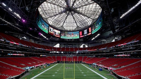 FILE - This is an Aug. 15, 2017, file photo, showing Mercedes-Benz Stadium in Atlanta. Nine months after Mercedes-Benz Stadium opened, what is being called the final construction phase of the facility's unique but problematic roof is set to begin on Tuesday, May 29, 2018. The goal is to complete the automation of the roof, allowing it to open and close in as little as 12 minutes.(AP Photo/David Goldman, File)
