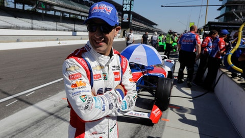 Tony Kanaan, of Brazil, waits in front of his car for the start of the final practice session for the IndyCar Indianapolis 500 auto race at Indianapolis Motor Speedway, in Indianapolis Friday, May 25, 2018. (AP Photo/Darron Cummings)