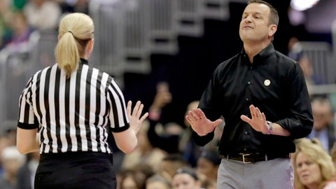 Louisville head coach Jeff Walz argues with an official during the first half against Mississippi State in the semifinals of the women's NCAA Final Four college basketball tournament, Friday, March 30, 2018, in Columbus, Ohio. (AP Photo/Tony Dejak)
