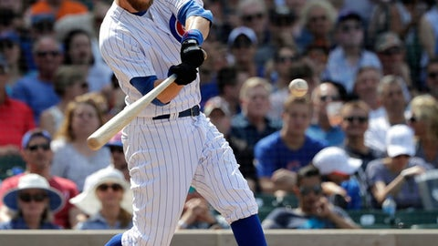 Chicago Cubs' Ben Zobrist hits a two-run double off San Francisco Giants relief pitcher Will Smith during the seventh inning of a baseball game Friday, May 25, 2018, in Chicago. Ian Happ and Javier Baez scored on the play. (AP Photo/Charles Rex Arbogast)