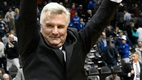 Kansas State head coach Bruce Weber celebrates a win over Kentucky after a regional semifinal NCAA college basketball tournament game, Friday, March 23, 2018, in Atlanta. Kansas State won 61-58. (AP Photo/John Amis)