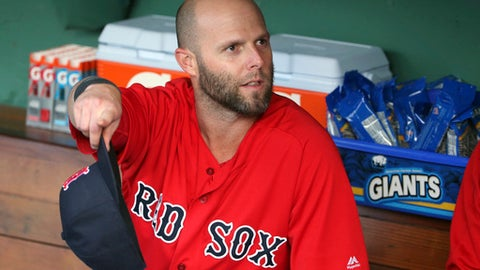 Boston Red Sox second baseman Dustin Pedroia speaks to teammates in the dugout before an interleague baseball game against the Atlanta Braves at Fenway Park, Friday, May 25, 2018, in Boston. Pedroia is making his return after recovering from an injury. (AP Photo/Elise Amendola)