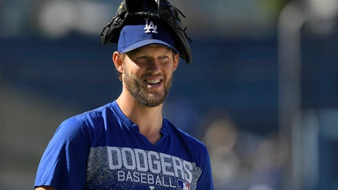 Los Angeles Dodgers pitcher Clayton Kershaw attends batting practice prior to a baseball game against the San Diego Padres, Friday, May 25, 2018, in Los Angeles. (AP Photo/Mark J. Terrill)
