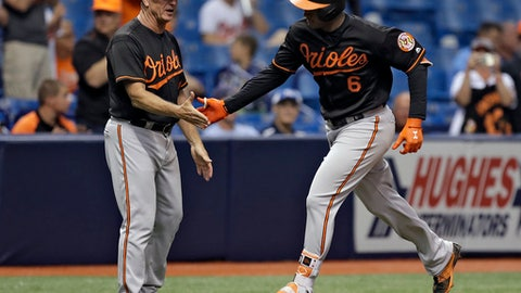 Baltimore Orioles' Jonathan Schoop (6) shakes hands with third base coach Bobby Dickerson after Schoop hit a home run off Tampa Bay Rays relief pitcher Ryan Yarbrough during the sixth inning of a baseball game Friday, May 25, 2018, in St. Petersburg, Fla. (AP Photo/Chris O'Meara)