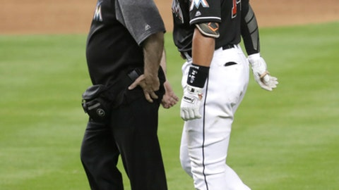 Miami Marlins' Martin Prado (14) leaves a baseball game with an apparent hamstring injury during the sixth inning against the Washington Nationals, Friday, May 25, 2018, in Miami. (AP Photo/Lynne Sladky)