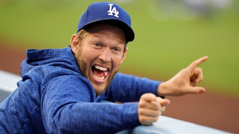 Los Angeles Dodgers pitcher Clayton Kershaw jokes around in the dugout prior to a baseball game against the San Diego Padres, Friday, May 25, 2018, in Los Angeles. (AP Photo/Mark J. Terrill)