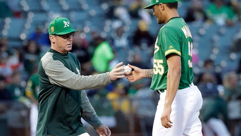Oakland Athletics manager Bob Melvin, left, pulls starter Sean Manaea during the fourth inning of the team's baseball game against the Arizona Diamondbacks on Friday, May 25, 2018, in Oakland, Calif. (AP Photo/Marcio Jose Sanchez)