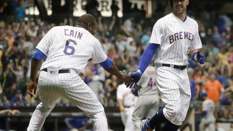 Milwaukee Brewers' Travis Shaw celebrates his walk off walk with teammate Lorenzo Cain (6) during the 10th inning of a baseball game against the New York Mets Friday, May 25, 2018, in Milwaukee. The Brewers won 4-3. (AP Photo/Morry Gash)