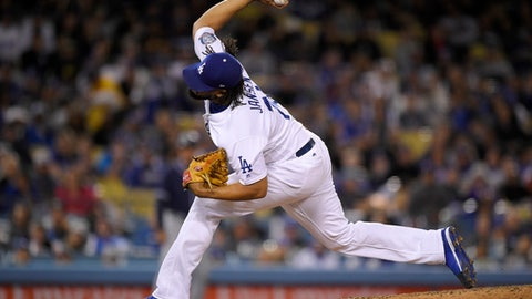 Los Angeles Dodgers relief pitcher Kenley Jansen throws during the ninth inning of the team's baseball game against the San Diego Padres on Friday, May 25, 2018, in Los Angeles. (AP Photo/Mark J. Terrill)