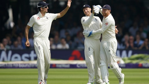 England's wicketkeeper Jos Butler, right celebrates with teammates after catching Pakistan's Mohammad Abbas out off the bowling of England's Mark Wood during the third day of play of the first test cricket match between England and Pakistan at Lord's cricket ground in London, Saturday, May 26, 2018. (AP Photo/Alastair Grant)
