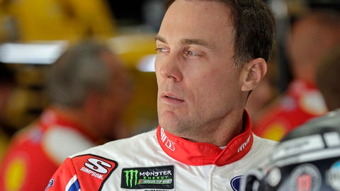 Kevin Harvick looks from the garage before practice for the NASCAR Cup series auto race at Charlotte Motor Speedway in Charlotte, N.C., Saturday, May 26, 2018. (AP Photo/Chuck Burton)