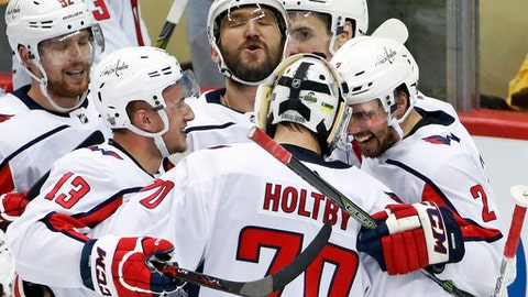FILE - In this May 7, 2018, file photo, Washington Capitals goaltender Braden Holtby (70) celebrates with Evgeny Kuznetsov (92), Jakub Vrana (13), Alex Ovechkin, top center, and Matt Niskanen (2) after Kuznetsovs' game-winning goal in the overtime period in Game 6 of an NHL second-round hockey playoff series against the Pittsburgh Penguins in Pittsburgh. Ovechkin is having fun, scoring goals, leading the Capitals to the Stanley Cup Final and destroying the bad rep some laid on him for not being able to get past the second round of the playoffs. (AP Photo/Gene J. Puskar, File)