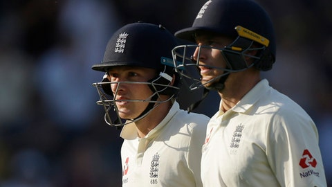 England's Don Bess, left and England's Jos Butler walk from the pitch at the end of play on the third day of play of the first test cricket match between England and Pakistan at Lord's cricket ground in London, Saturday, May 26, 2018. (AP Photo/Alastair Grant)