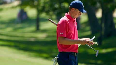 Jordan Spieth looks over his notes during the third round of the Fort Worth Invitational golf tournament at Colonial Country Club in Fort Worth, Texas, Saturday, May 26, 2018. (AP Photo/Cooper Neill)