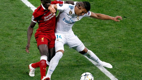 Liverpool's Sadio Mane, left, and Real Madrid's Casemiro, right, challenge for the ball during the Champions League Final soccer match between Real Madrid and Liverpool at the Olimpiyskiy Stadium in Kiev, Ukraine, Saturday, May 26, 2018. (AP Photo/Darko Vojinovic)