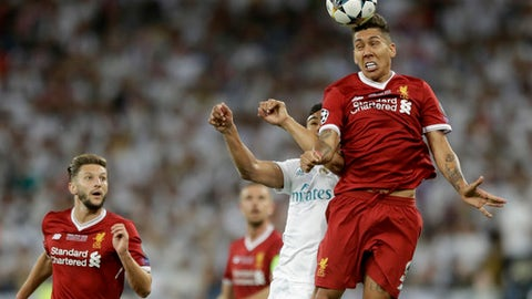 Liverpool's Roberto Firmino jumps for the ball next to Real Madrid's Casemiro during the Champions League Final soccer match between Real Madrid and Liverpool at the Olimpiyskiy Stadium in Kiev, Ukraine, Saturday, May 26, 2018. (AP Photo/Matthias Schrader)