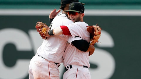 Boston Red Sox second baseman Dustin Pedroia. right, gets a hug from shortstop Xander Bogaerts after their 8-6 win over the Atlanta Braves in a baseball game at Fenway Park in Boston Saturday, May 26, 2018. (AP Photo/Winslow Townson)