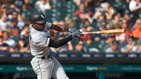 Chicago White Sox's Tim Anderson hits a solo home run in the sixth inning of a baseball game against the Detroit Tigers in Detroit, Saturday, May 26, 2018. (AP Photo/Paul Sancya)