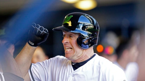 Milwaukee Brewers' Erik Kratz reacts in the dugout after hitting a home run against the New York Mets during the fifth inning of a baseball game Saturday, May 26, 2018, in Milwaukee. (AP Photo/Jeffrey Phelps)