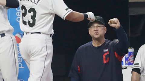 Cleveland Indians manager Terry Francona, right, congratulates Michael Brantley after Brantley hit a solo home run during the seventh inning of a baseball game against the Houston Astros, Saturday, May 26, 2018, in Cleveland. (AP Photo/Tony Dejak)