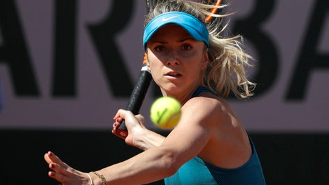 Ukraine's Elina Svitolina returns the ball to Australia's Ajla Tomljanovic during their first round match of the French Open tennis tournament at the Roland Garros Stadium, Sunday, May 27, 2018 in Paris. (AP Photo/Alessandra Tarantino)