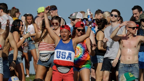 Fans dance during a pre-race concert before the Indianapolis 500 auto race at Indianapolis Motor Speedway, in Indianapolis Sunday, May 27, 2018. (AP Photo/Darron Cummings)