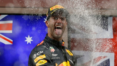 Red Bull driver Daniel Ricciardo of Australia celebrates on the podium after winning the Formula One race, at the Monaco racetrack, in Monaco, Sunday, May 27, 2018. (AP Photo/Claude Paris)