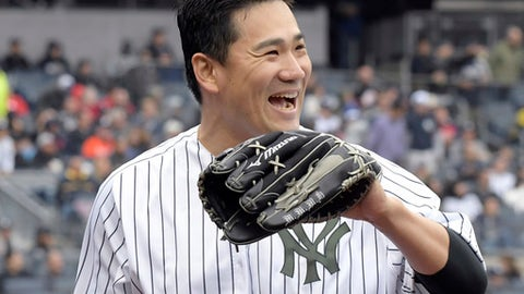 New York Yankees starting pitcher Masahiro Tanaka reacts after New York Yankees right fielder Giancarlo Stanton made a diving catch to end the sixth inning of a baseball game against the Los Angeles Angels, Sunday, May 27, 2018, at Yankee Stadium in New York. (AP Photo/Bill Kostroun)