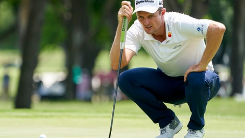 Justin Rose prepares to putt on the seventh hole during the final round of the Fort Worth Invitational golf tournament at Colonial Country Club in Fort Worth, Texas, Sunday, May 27, 2018. (AP Photo/Cooper Neill)