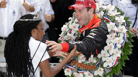 Will Power, of Australia, apologizes to 2018 500 Festival Queen Scholar Natalie Murdock after dousing her with milk while celebrating the win at the Indianapolis 500 auto race at Indianapolis Motor Speedway, in Indianapolis Sunday, May 27, 2018. (AP Photo/Darron Cummings)