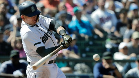 Seattle Mariners' Ryon Healy hits a two-RBI double in the eighth inning of a baseball game against the Minnesota Twins, Sunday, May 27, 2018, in Seattle. (AP Photo/Ted S. Warren)