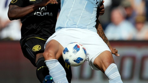 Sporting Kansas City forward Khiry Shelton, front, works in front of Columbus Crew defender Lalas Abubakar, back, during the first half of an MLS soccer match in Kansas City, Kan., Sunday, May 27, 2018. (AP Photo/Orlin Wagner)